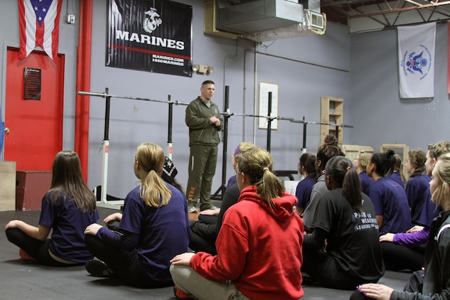 Recruiting Station Cleveland commanding officer, U.S. Marine Corps Maj. Jonathan Glover, leads the question and answer portion of the female pool function held at the Crossfit Box in Strongsville, Ohio on Nov. 23, 2013. He started it off by explaining the importance of being mentally and physically ready for the demands of recruit training. The poolees were given the opportunity to ask any question they wanted to gain knowledge and insight on how to be successful. Earlier in the morning the poolees started off the function with a circuit course style workout that focused on building upper body strength. (U.S. Marine Corps Photo by Sgt. T.M. Stewman/Released)