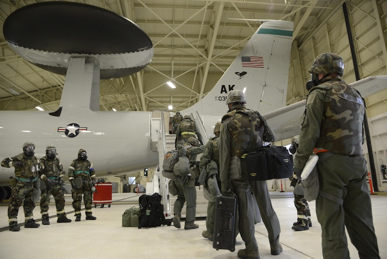 Members of the 962nd Airborne Air Control Squadron board an E-3 Sentry Airborne Warning and Control System as part of Exercise Polar Force 13-9 Nov. 6, 2013, at Joint Base Elmendorf-Richardson, Alaska. The readiness exercise is designed to validate the wing's ability integrate, mobilize and prepare assigned personnel, aircraft and equipment for their wartime mission and to employ forces and weapons systems to perform the tasked mission.