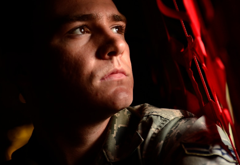 U.S. Air Force Airman 1st Class Kyle Eccles, 317th Aircraft Maintenance Squadron crew chief, looks out the side window of a C-130J Super Hercules Nov. 21, 2013, during Impact Day at Dyess Air Force Base, Texas. Impact Day gave aircraft maintainers a chance to shadow aircrew personnel as they conducted an airdrop resupply training mission. (U.S. Air Force photo by Staff Sgt. Vernon Young Jr./Released)