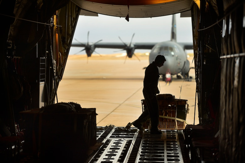 U.S. Air Force Senior Airman Matthew Bihlajama, 40th Airlift Squadron loadmaster, secures cargo on a C-130J Super Hercules Nov. 21, 2013, during Impact Day at Dyess Air Force Base, Texas. Impact Day gave 317th Airlift group maintainers a chance to see each step the aircrew has to take in order to complete an airdrop resupply mission. (U.S. Air Force photo by Staff Sgt. Vernon Young Jr./Released)
