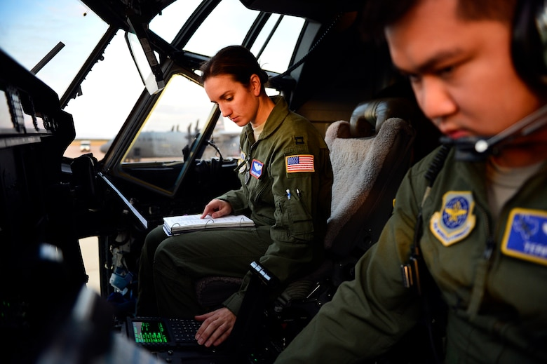 U.S. Air Force Captain Terry Wu, 40th Airlift Squadron, and Captain Heather Lendrum, 39th Airlift Squadron, C-130J Super Hercules pilots, perform preflight checks Nov. 21, 2013, during Impact Day at Dyess Air Force Base, Texas. Impact Day was designed to give maintainers and aircrew personnel a chance to see what each other do on a daily basis . Preflight checks are performed to ensure every system on the aircraft is operating correctly and safely prior to flight. (U.S. Air Force photo by Staff Sgt. Vernon Young Jr./Released)