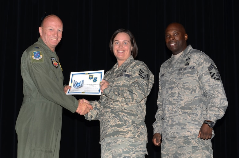 Staff Sgt. Amanda Hoffman, 612th Air and Space Operations Center, receives a certificate from Col. Bruce Smith, 12th Air Force (Air Forces Southern) vice commander, congratulating her on her promotion to technical sergeant at the base theater on Davis-Monthan AFB, Ariz., Nov. 27, 2013.  Hoffman's promotion will go into effect on Dec. 1. (U.S. Air Force photo by Staff Sgt. Heather R. Redman/Released)