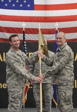 U.S. Air Force Lt. Col. Ronald N. Speir, Jr. from the 117th Air Control Squadron, Georgia Air National Guard received the guidon from Col. Timothy A. Gosnell, Nov. 17, 2013 at a deployed location in Southwest Asia. Speir took command of the 727th Expeditionary Air Control Squadron as duties transitioned from the 255 ACS, Mississippi Air National Guard to the 117 ACS. (U.S. Air Force photo by Senior Airman Jacob Morgan/released)
