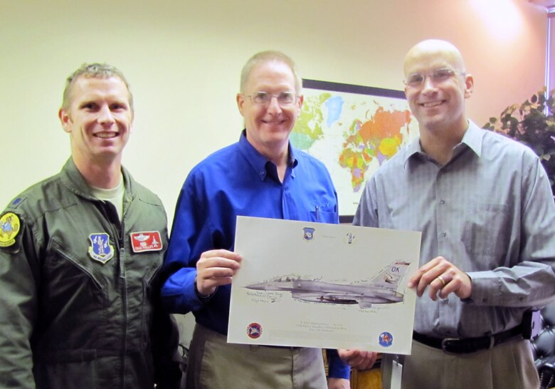 Lt Col Chad Phillips and SMSgt David Sudweeks, 138th Fighter Wing safety office,  present Mr. Rob Mutersbaugh, Vice President of Operations, Ramsey Industries, with an F-16 lithograph as a token of their appreciation for the employer support shown by Ramsey Industries during a short notice deployment by SMSgt Sudweeks.  (U.S. Air Force photo by Senior Master Sgt. Bryan Hilbert/Released)