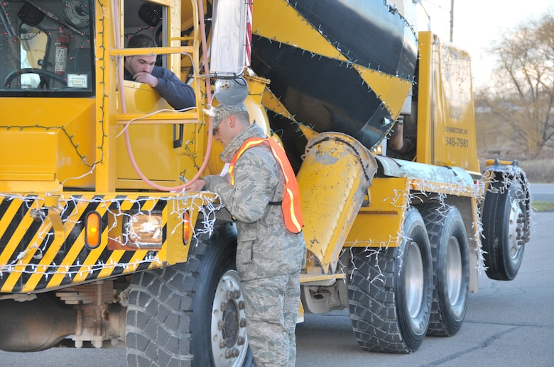SCHENECTADY, N.Y. -- 2nd Lt. Jared Semerad, 109th Logistics Readiness Squadron, directs a parade participant where to park in preparation for the 46th annual Gazette Holiday Parade on Nov. 23, 2013. About 20 volunteers with the 109th Airlift Wing, including some family members, volunteered to help usher the floats in for the parade. (Air National Guard photo by Tech. Sgt. Catharine Schmidt/Released)