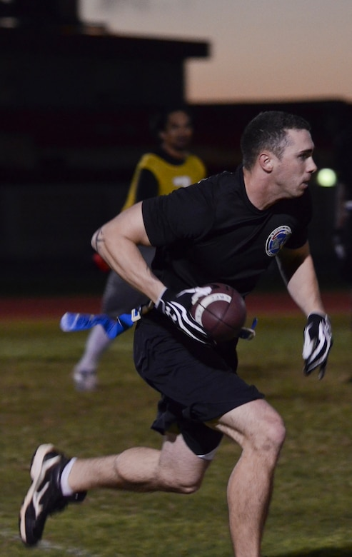 Christopher Durham, 94th Army Air and Missile Defense Command, runs down the field during an intramural flag football game Nov. 25, 2013, on Andersen Air Force Base, Guam. The 94th AAMDC defeated 22nd Space Operations Squadron Detachment 5, 40-0. (U.S. Air Force photo by Senior Airman Marianique Santos/Released)