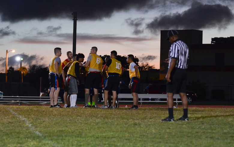 Players from the 22nd Space Operations Squadron Detachment 5 huddle during a timeout Nov. 25, 2013, at an intramural flag football game on Andersen Air Force Base, Guam. The 94th Army Air and Missile Defense Comman defeated 22nd SOPS Det 5, 40-0. (U.S. Air Force photo by Senior Airman Marianique Santos/Released)