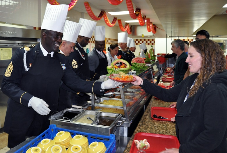 U.S. Army Command Sgt. Maj. Norriel Fahie, Army Support Activity, serves a plate of Thanksgiving dinner to a member of Joint Task Force-Bravo at the Soto Cano Air Base dining facility, Nov. 26, 2013.  Members of Joint Task Force-Bravo were treated to a Thanksgiving Day meal with all the trimmings in celebration of the holiday.  Joint Task Force-Bravo leadership, as well as leaders from the Army Support Activity, Army Forces Battalion, Joint Security Forces, 612th Air Base Squadron, 1-228th Aviation Regiment, and Medical Element wore their dress uniforms and served the members of the Task Force. (U.S. Air Force photo by Capt. Zach Anderson)