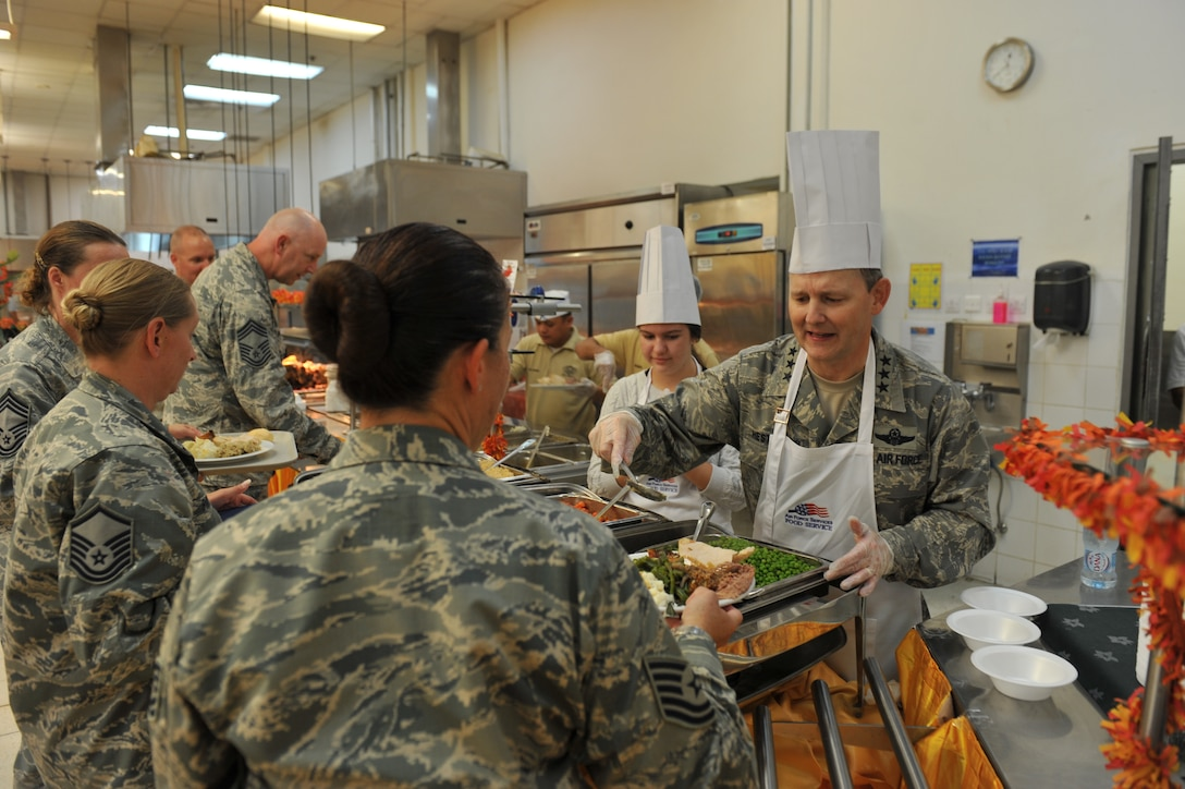 Lt. Gen. John Hesterman III, U.S. Air Forces Central Command commander serves Thanksgiving day meals to service members assigned to the 379th Air Expeditionary Wing and tenant units in Southwest Asia, on Nov. 28, 2013. (U.S. Air Force photo/Master Sgt. David Miller)