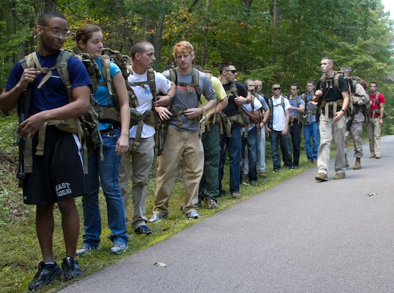 Marines and candidates with Officer Selection Office Raleigh, Marine Corps Recruiting Station Raleigh, stop for a gear check during a three-mile hike aboard Umstead Park in Raleigh, N.C., Sept. 28, 2013. The candidates and Marines carried packs with 40 pounds of gear and an M-16 replica rubber rifle to get a feel for hiking while carrying weight.  (U.S. Marine Corps photo by Sgt. Dwight A. Henderson/Released)