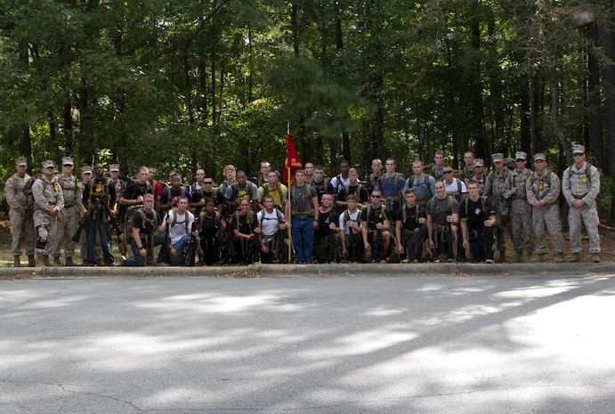 Marines and candidates with Officer Selection Office Raleigh, Marine Corps Recruiting Station Raleigh, pose for a photo following a three-mile hike aboard Umstead Park in Raleigh, N.C., Sept. 28, 2013. The candidates and Marines carried packs with 40 pounds of gear and an M-16 replica rubber rifle to get a feel for hiking while carrying weight.  (U.S. Marine Corps photo by Sgt. Dwight A. Henderson/Released)