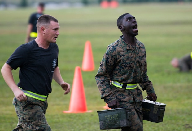 A student with Infantry Training Battalion runs with ammo cans during the Combat Fitness Test at Camp Geiger, N.C., Sept. 26, 2013. The students, regardless of gender, must pass the same ITB standard for the physical fitness test and CFT to continue in the course. The students are part of the first ITB company to include female Marines as part of ongoing research into opening combat-related job fields to women. This photograph has been digitally altered to remove the student's nametape.