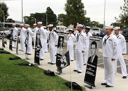 Sailors from the Naval Hospital Camp Pendleton 1st Class Petty Officers Association display the names and portraits of seven Navy hospital corpsmen still missing from the Vietnam War during a service of remembrance at the NHCP Prisoner of War/Missing in Action Memorial on National POW/MIA Recognition Day Sept. 20.   Naval Hospital Camp Pendleton held its 23nd annual Prisoner of War/Missing in Action Remembrance Ceremony on the front lawn of the hospital at the POW/MIA memorial site.   (U.S. Navy photo by Petty Officer 1st Class Michael R. McCormick)