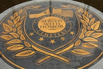 The logo of the Clark Veterans Cemetery displays the long relationship between the Republic of the Philippines and the United States of America. The Clark Veterans Cemetery is located in Clark, Pampanga, Republic of the Philippines. Service members from combat engagements like the Spanish-American War, Philippine-American War, World War I, World War II, Operation Iraqi Freedom and Operation Enduring Freedom are interred on the site grounds. U.S. Marines from 3d Marine Expeditionary Brigade, III Marine Expeditionary Force, who conducted a voluntary cleanup at the cemetery, are in the Philippines conducting Amphibious Landing Exercise 2014. PHIBLEX 14 is an exercise designed to improve Philippine-U.S. interoperability, increase readiness, and enhance the ability for a bilateral force to respond to natural disasters or other regional contingencies. (U.S. Marine Corps photo by Lance Cpl. Jose D. Lujano/ Released)