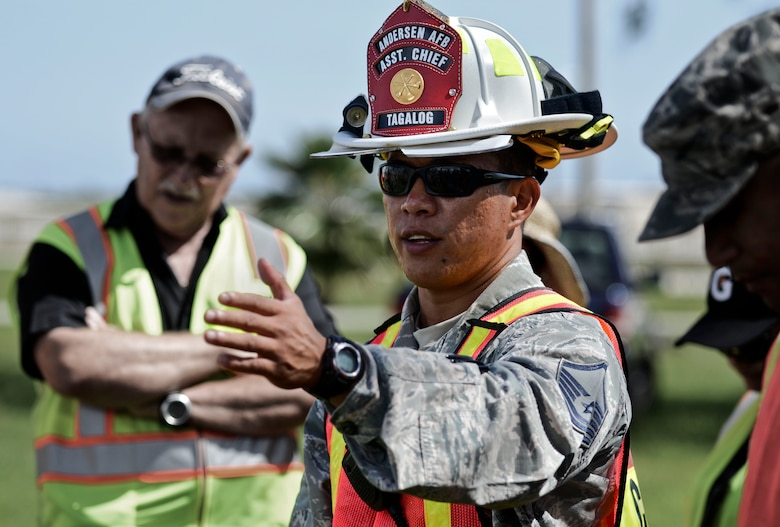 Master Sgt. Francis Tagalog, 36th Civil Engineer Squadron Fire and Emergency Services incident commander for the event, thanks the participating agencies after completing the field training exercise portion of the annual multi-agency fuel spill response training event Sept. 26, 2013, at the 36th Logistics Squadron Fuels Management Flight compound on Andersen Air Force Base, Guam. More than 29 people from a total of eight agencies participated in the exercise, to include representatives from 36th Medical Group, 36th LRS, 36th Security Forces Squadron and DZSP-21. (U.S. Air Force photo by Senior Airman Marianique Santos/Released)