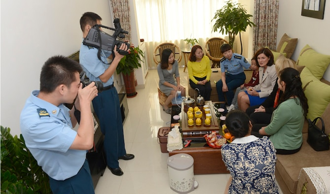 """Betty Welsh, wife of Air Force Chief of Staff Gen. Mark A. Welsh III, and Athena Cody, wife of Chief Master Sgt. of the Air Force James Cody, meet with pilots' wives from the 24th Air Division Sept. 26, 2013, in a home at an air base south of Beijing, China. Welsh, along with Gen. """"Hawk"""" Carlisle and Cody, visited with various military leaders as part of a weeklong visit."""