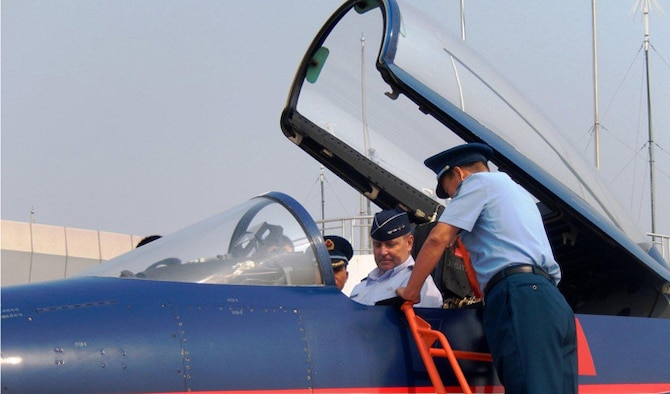 "Air Force Chief of Staff Gen. Mark A. Welsh III receives an orientation of a People's Liberation Army Air Force J-10 fighter Sept. 27, 2013, at Nanyuan Air Base, China. Welsh, along with Gen. ""Hawk"" Carlisle and Chief Master Sgt. of the Air Force James A. Cody, visited with various military leaders as part of a weeklong visit to China."