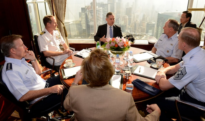 "Clifford Hart, U.S. consul general in Hong Kong, speaks with Gen. Mark A. Welsh III, Air Force chief of staff, Gen. ""Hawk"" Carlisle, Pacific Air Forces commander, Heidi Grant, deputy under secretary of the Air Force for International Affairs, and Chief Master Sgt. of the Air Force James Cody, about the unique environment in Hong Kong Sept. 29, 2013.  The meeting was part of a weeklong visit to China, which involved meetings with military counterparts and other civil and political leadership in Beijing, Hangzhou and Hong Kong."