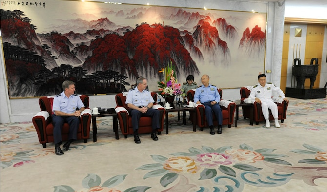 """Air Force Chief of Staff Gen. Mark A. Welsh III meets with Vice Chairman of the Central Military Commission Gen. Xu Qiliang Sept. 26, 2013, in Beijing, China. Welsh, along with Gen. """"Hawk"""" Carlisle and Chief Master Sgt. of the Air Force James A. Cody, visited with various military leaders as part of a weeklong visit to the country."""