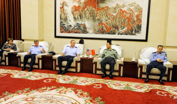 "Air Force Chief of Staff Gen. Mark A. Welsh III meets with officials at the Capital Air Defense Command Center Sept. 26, 2013, in Beijing, China. Welsh, along with Gen. Herbert ""Hawk"" Carlisle and Chief Master Sgt. of the Air Force James A. Cody, visited with various military leaders as part of a weeklong visit to the country."