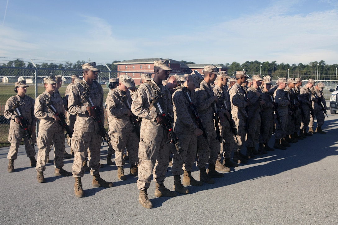 Marines with 3rd platoon, Company I, Marine Combat Training Battalion, await the orders of their combat instructors at the armory aboard Camp Geiger, Sept. 24. Each company has four platoons of Marines.