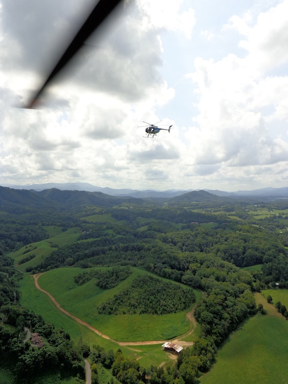 An aerial view from one ERAD aircraft shows a second aircraft conducting marijuana searches in East Tennessee. (photo by DEA special agent)
