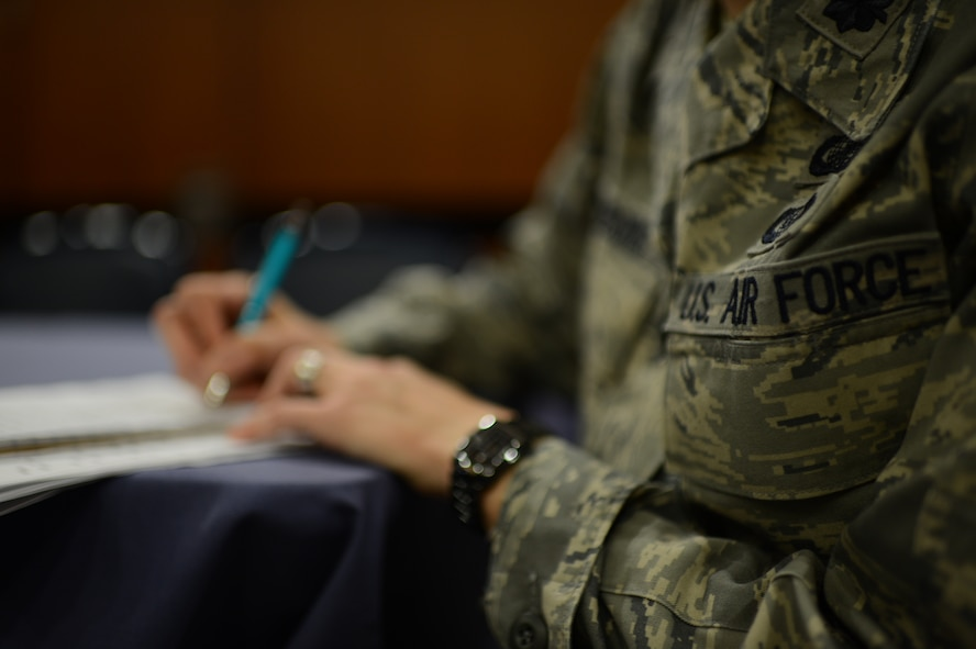 SPANGDAHLEM AIR BASE, Germany – A member from the Air Force Sexual Assault Prevention & Response Headquarters, located in the Pentagon, takes notes of comments and suggestions made by Spangdahlem Airmen in an Air Force-wide focus group in combating sexual assault Sept. 26, 2013. The mission of the groups was to hear what the Airmen think are the problems and how they think we can lessen these problems. (U.S. Air Force photo by Airman 1st Class Gustavo Castillo/Released)