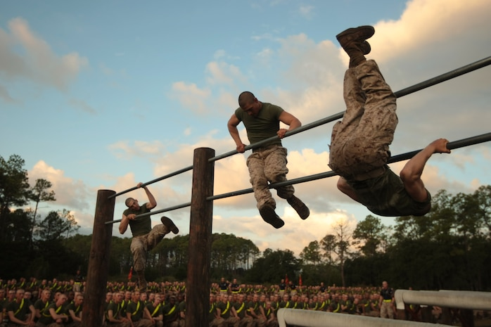 Recruits of Mike Company, 3rd Recruit Training Battalion, race through an obstacle course Sept. 21, 2013, as part of a field meet on Parris Island, S.C. Drill instructors selected a team of recruits from each platoon to compete in various events such as tug of war, a relay race, an obstacle course race and a pushup competition. The meet is designed to motivate the recruits for the upcoming Crucible, the 54-hour culminating event of training.