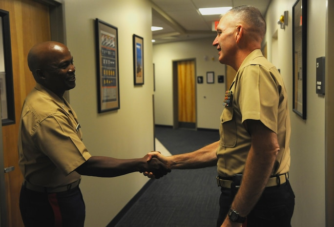 Marine Maj. Gen. Mark A. Brilakis, commanding general, Marine Corps Recruiting Command, meets with Lt. Col. Eric S. Johnson, deputy for recruiting operations at 8th Marine Corps District, Naval Air Station Fort Worth Joint Reserve Base, Texas, Oct. 2nd, 2013. Brilakis took command of the Western Recruiting Region on July 12th, 2013.