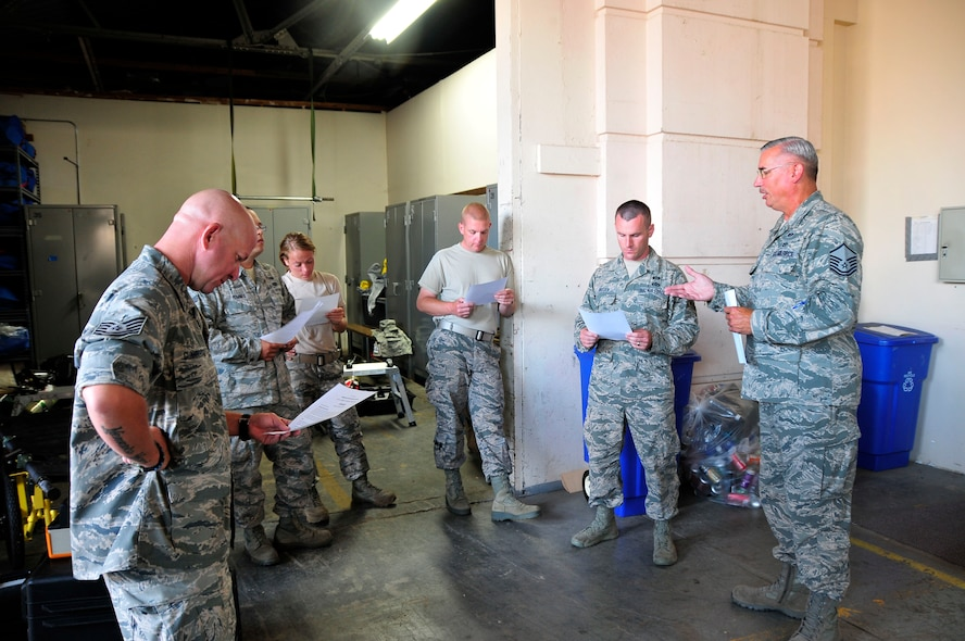 Members of the 134th Air Refueling Wing Civil Engineer Squadron Emergency Management team listen to Master Sgt. Chris King, 134 ARW Emergency Manager,  as he covers the scenario for a training exercise during a deployment to Joint Base Pearl Harbor- Hickam, Hawaii August 03-17.  (U.S. Air National Guard photo by Master Sgt. Kendra M Owenby/Released)