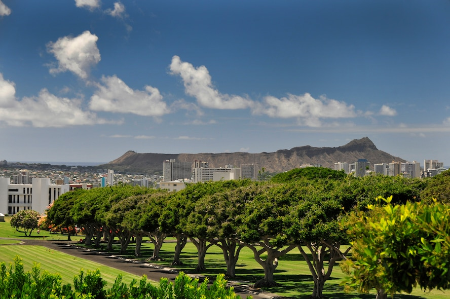 """Members of the 134th Air Refueling Wing Civil Engineer Squadron and Public Affairs paid thier respects at  the National Memorial Cemetery of the Pacific better known as """"The Punchbowl"""" during a deployment to Joint Base Pearl Harbor-Hickam, Hawaii  August 03-17. Diamond Head crater can be seen in the background.  (U.S. Air National Guard photo by Master Sgt. Kendra M Owenby/Released)"""