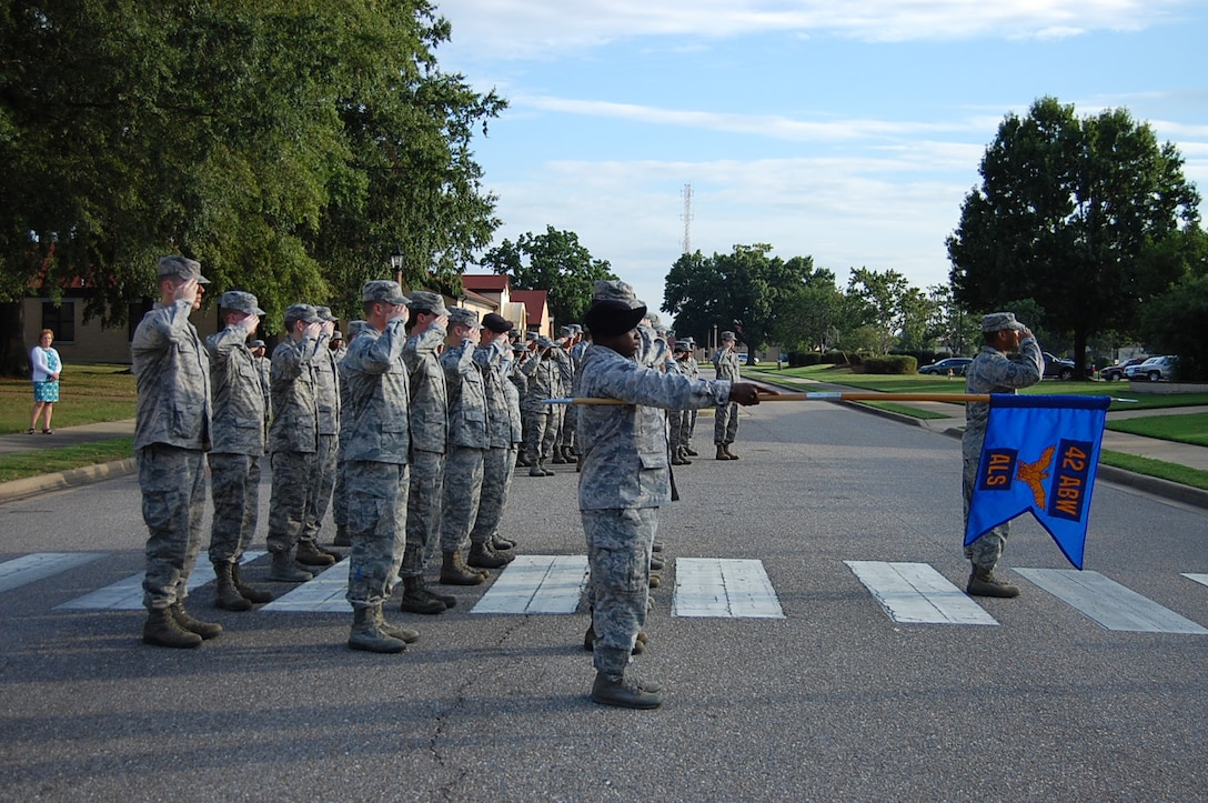 Maxwell Air Force Base Airman Leadership School class 13-7 solutes the flag while conducting retreat, Oct. 3. Despite budgetary constraints, ALS is continuing here throughout the government shutdown. (Courtesy photo)