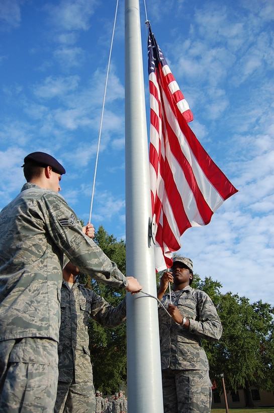 Maxwell Air Force Base Airman Leadership School class 13-7 lowers the flag while conducting retreat, Oct. 3. Despite budgetary constraints, ALS is continuing here throughout the government shutdown. (Courtesy photo)