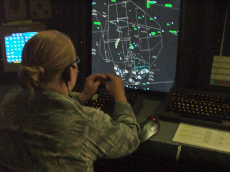 Senior Airman Caitlin Sullivan, 49th Operation Support Squadron air traffic controller, monitors the standard approach radar system at the J.W. Cox Range Control Center at White Sands Missile Range, N.M., Sept. 30. A standard approach radar system is a live feed which shows the correlation between aircraft and the airfield. Airmen from Holloman Air Force Base are stationed at WSMR to run the air traffic operations. (U.S. Air Force photo by Airman 1st Class Aaron Montoya/Released)