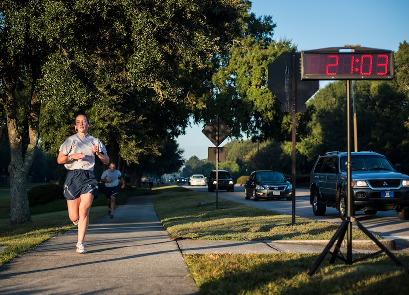 Capt. Marie Harnly, 628th Civil Engineer Squadron Chief of Operations Engineering, pushes towards the finish line during the Commander's Challenge Run Oct. 4, 2013, at Joint Base Charleston – Air Base, S.C. The Commander's Challenge is held monthly to test Team Charleston's fitness abilities. Harnly was the top female runner with a time of 21:04. (U.S. Air Force photo/ Senior Airman Dennis Sloan)