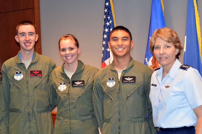 (Left to right): Cadet 1st Class Michael Gallagher, Cadet 2nd Class Cori Easter, Cadet 2nd Class Jacob Seabury, and Lt. Gen. Michelle Johnson. Easter and Seabury were recognized as the first cadet instructors of the Academy's unmanned aerial systems program after completing qualification training at Hurlburt Field, Fla. (U.S. Air Force Photo/Tech. Sgt. Vann Miller)