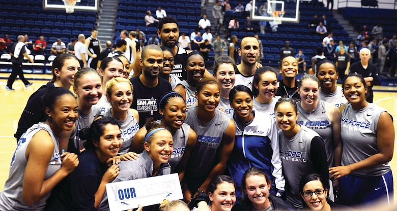The Falcon women's basketball team gather for pictures with Tony Parker, Tim Duncan and Manu Ginobili after the Spurs practice session in Clune Arena. (U.S. Air Force Photo/1st Lt. Brandon Baccam)
