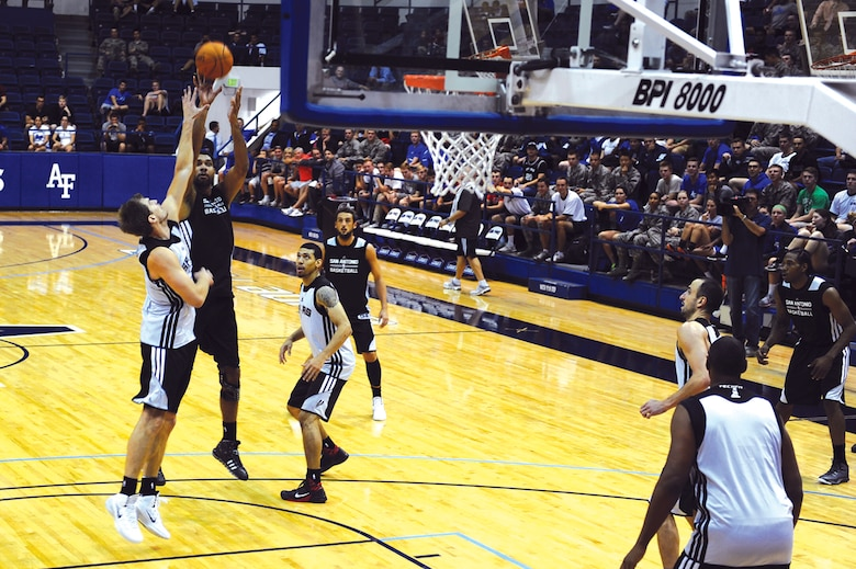 Spurs star forward Tim Duncan (second from left) goes up for a shot during Wednesday evening's practice session at Clune Arena. The Spurs opened their training camp here Oct. 1. (U.S. Air Force Photo/Master Sgt. Kenneth Bellard)