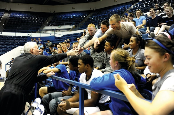 Academy cadets reach out to shake hands with Spurs head coach Gregg Popovich before the start of the team's practice Wednesday at Clune Arena. (U.S. Air Force Photo/Master Sgt. Kenneth Bellard)