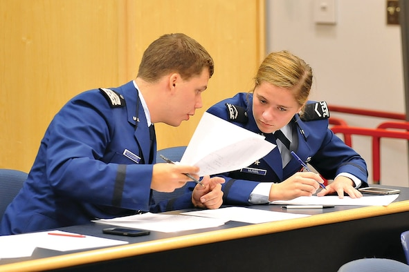 Cadet 4th Class Thomas Woodward (left) and Cadet 3rd Class Ellen Munsil prepare to debate at the Forensics Classic in Fairchild Hall Sept. 27. (U.S. Air Force Photo/Liz Copan)