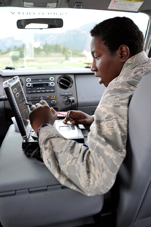 Cadet 3rd Class Melissa Gabriel follows a GPS signal of the RQ-11 Raven while in a support vehicle. Responsibility will shift to cadets to run the SUAS program while officers and contractors serve as mentors. (U.S. Air Force Photo/Liz Copan)