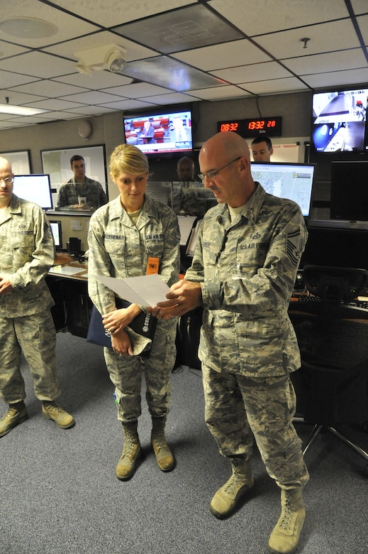 Senior Airman Bryenna Breckheimer, 2012 Air Force Global Strike Command Outstanding Airman of the Year, visits with Airmen from the 509th Bomb Wing Command Post at Whiteman Air Force Base, Mo., Sept. 25, 2013. Many Whiteman Airmen presented a variety of concerns to Breckheimer, on issues ranging from enlisted performance ratings to out-processing. (U.S. Air Force photo by Airman 1st Class Keenan Berry/Released)