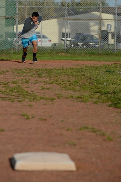 SPANGDAHLEM AIR BASE, Germany -- U.S. Air Force Airman 1st Class Lawrence Westmoreland, 52nd Fighter Wing financial services technician, sprints toward first base during the kickball of Wing Sports Day Oct. 3, 2013. A free barbeque and multiple sporting events highlighted the day's events.  (U.S. Air Force photo by Staff Sgt. Christopher Ruano/Released)