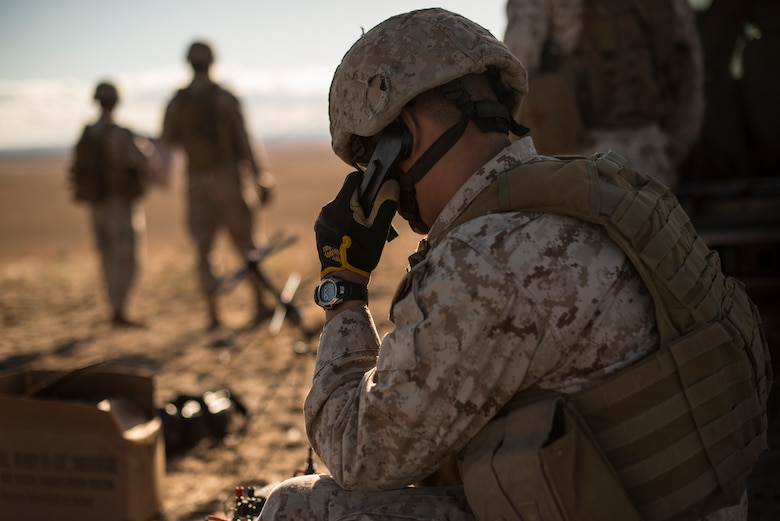 U.S. Marine radio operator from the 1st Air Naval Gunfire Liaison Company works a close-air support mission during exercise Mountain Roundup 2013 at Mountain Home Air Force Base, Idaho, Oct. 2, 2013. Marine Capt. Charles Watt, 1st ANGLICO officer in-charge, led a combined-joint joint terminal attack controller team consisting of Marine Forward Air Controllers, and both German and U.S. Air Force JTACs. (U.S. Air Force photo by Master Sgt. Kevin Wallace/RELEASED)