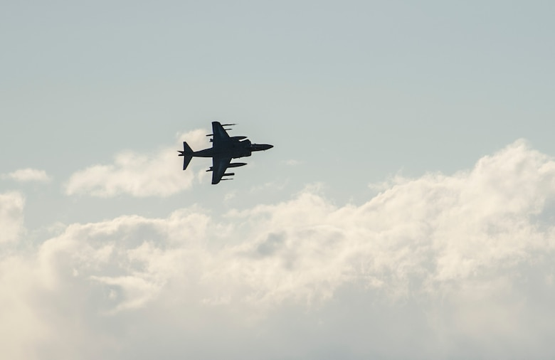 A U.S. Navy AV8-B Harrier buzzes a simulated enemy as a show of force, prior to returning and dropping a simulated bomb on target, Oct. 2, 2013, during exercise Mountain Roundup 2013. More than 300 Germans and Canadians, and an equal number of U.S. Navy, Marine Corps, Army and Air Force are participating in ground operations, close-air support, urban combatives, convoy operations, basic fighter maneuvers, counter air and multiple air-to-air training scenarios. (U.S. Air Force photo by Master Sgt. Kevin Wallace/RELEASED)