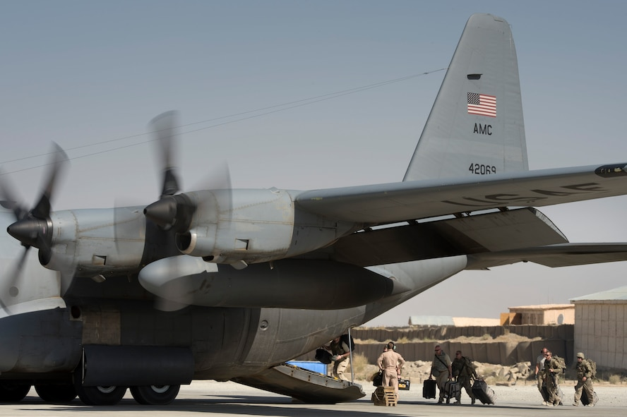 A number of final Department of Defense and military passengers board a 774th Expeditionary Airlift Squadron C-130 Hercules at Forward Operating Base Sharana, Paktika province, Afghanistan, Sept. 28, 2013. This mission marked a retrograde milestone as the 774th EAS transported the last cargo from FOB Sharana before the base is transferred to the Afghan Ministry of Defense.
