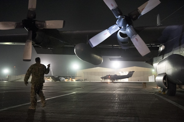 Staff Sgt. David Billings, 774th Expeditionary Airlift Squadron flight engineer, preflights a C-130 Hercules cargo plane before a mission out of Bagram Air Field, Afghanistan, Sept. 28, 2013. This mission marked a retrograde milestone as the 774th EAS transported the last cargo from Forward Operating Base Sharana, Paktika province, Afghanistan, before the base is transferred to the Afghan Ministry of Defense. Billings, a Cabot, Ark., native, is deployed from the Little Rock, Arkansas Air National Guard.