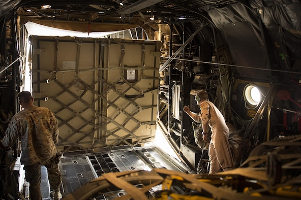 "Senior Airman Zac Sidders, 774th Expeditionary Airlift Squadron C-130 Hercules loadmaster, marshals in a ""tricon"" shipping container at Forward Operating Base Sharana, Paktika province, Afghanistan, Sept. 28, 2013. This mission marked a retrograde milestone as the 774th EAS transported the last cargo from FOB Sharana before the base is transferred to the Afghan Ministry of Defense. Sidders, a Peoria, Ill., native, is deployed from the Wyoming Air National Guard."