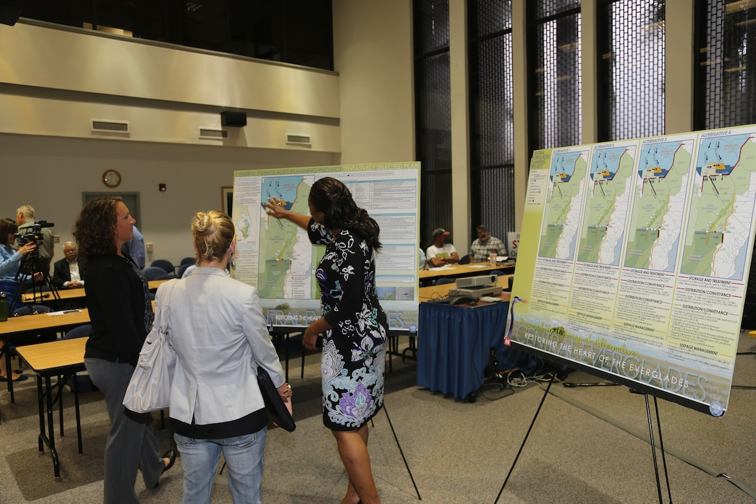 Murika Davis (right), CEPP engineering lead, and Gretchen Ehlinger (left), CEPP environmental lead, discuss the project's Tentatively Selected Plan with meeting attendants during the open house portion of the Sept. 17 meeting in Fort Myers, Fla. (