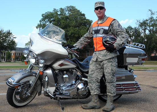 Chief Master Sergeant Vance Kondon, 14th Flying Training Wing Command Chief, stands by his Harley Davidson motorcycle Sep. 24 on Columbus AFB. Kondon wears all the proper personal protective equipment including pants, long sleeve shirt, reflective vest, over-the-ankle shoes, gloves and a Department of Transportation approved helmet. (U.S. Air Force Photo/Amn Daniel Lile)